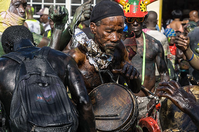 The jab jabs drumming and chanting during j'ouvert.  The black oil, drums, chains, and horns all have roots from the days of emancipation.
