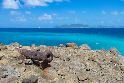 Gun Point on the north side of Carriacou.  The British placed this cannon in the late 18th century to divide the administration zones between Grenada and St. Vincent.  Union Island in the background.