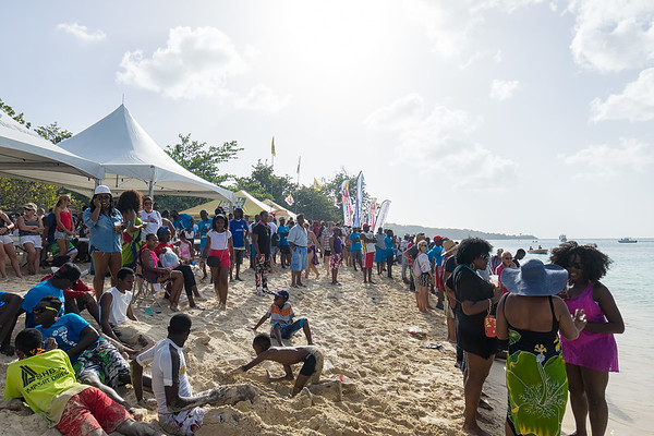 Crowds watching the race at Grand Anse Beach.