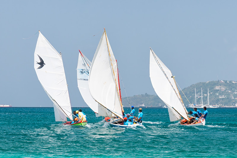Workboats working for position at the Grenada Sailing Festival.