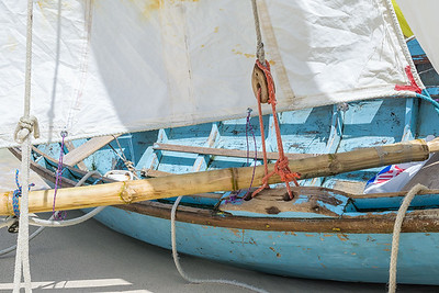 Workboats with wooden blocks and bamboo spars.