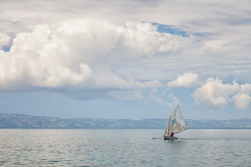 Fishermen on Ile A Vache, Haiti, construct sails with whatever materials they can find, mostly old sails that have been donated to them.