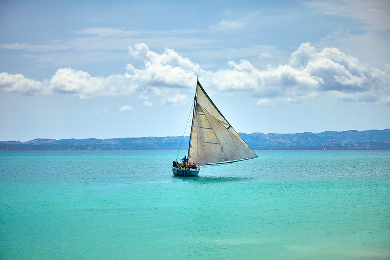 """Fufei""'s sails are made up of three smaller sails donated to the island over the years."