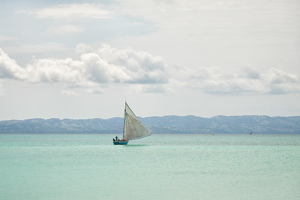 """Fufei"", the Foundation's sailboat, leaving Baie La Hatte after dropping off a load of supplies."