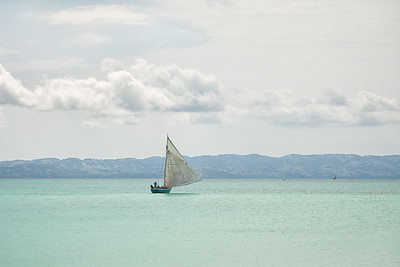 """""""Fufei"""", the Foundation's sailboat, leaving Baie La Hatte after dropping off a load of supplies."""