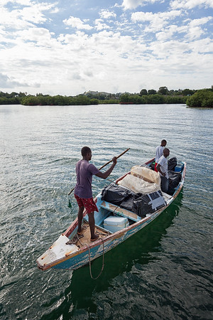 After filling up the small boat with sails and sewing machines brought to Haiti on a bigger sailboat, taking them ashore to be distributed to locals who need them.