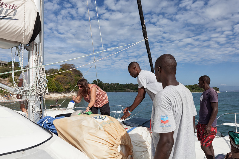 Offloading old sails that have been donated to the fishermen on Ile A Vache, Haiti.