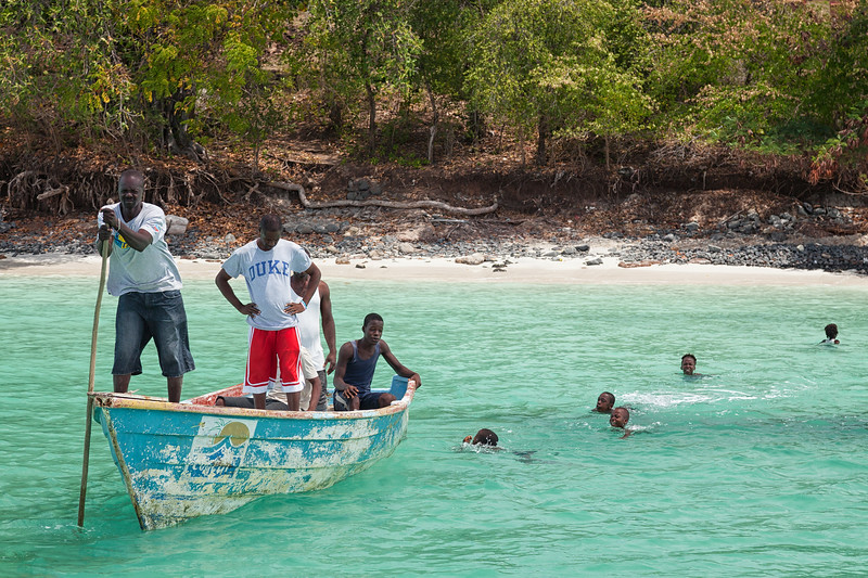 Boys follow Silnor and his crew as they come back to our boat for another round of supplies.  La Hatte, Ile A Vache, Haiti.