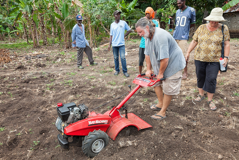 Wayne tests out the roto-tiller before teaching the locals how to use it.