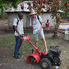 Anous and Jan talk about the roto-tiller at Anous' house in La Hatte.