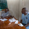 Phelix and Bienamié make a list of things to discuss with the commissioner during their visit with him on Thursday, regarding the school.