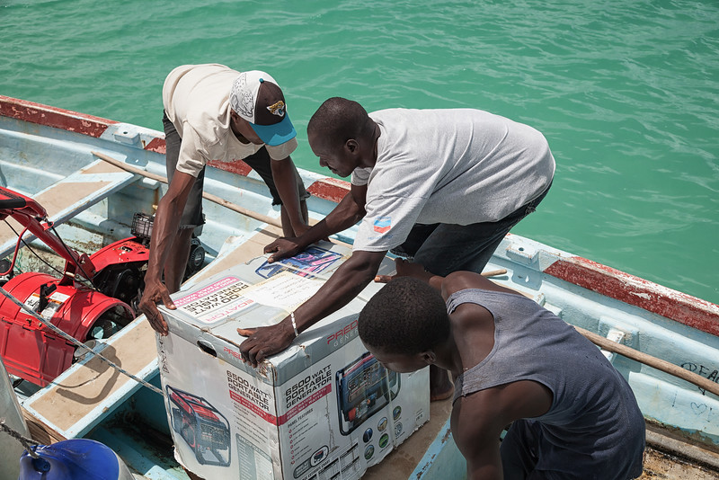 Setting a donated generator in the boat to be taken ashore in La Hatte, Ile A Vache, Haiti.