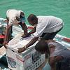 Setting a donated generator in the boat to be taken ashore in La Hatte, Ile A Vache, Haiti.