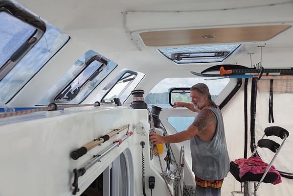 Captain Wayne navigating back to Tou Milieu after offloading supplies in La Hatte.