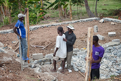 Sinking the corner posts of the hen house in La Hatte.