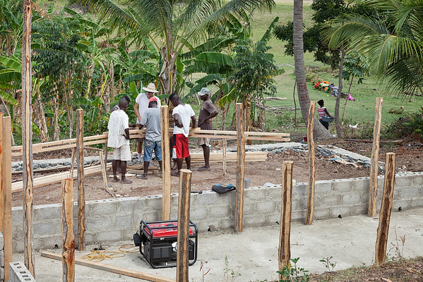 Working on the rafters for the hen house in La Hatte.