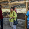 Anouse, the agronomist, discussing the hen house with Mandy.