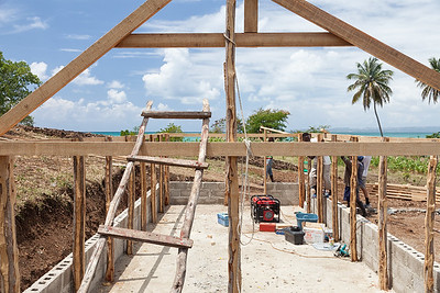 Getting the first roofing rafter up on the hen house in La Hatte.