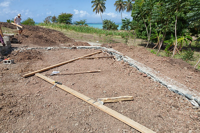 Laying out the pattern for the roofing structure of the hen house.