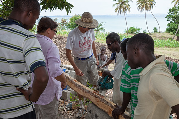 Some of the locals getting their first lesson on power tools.