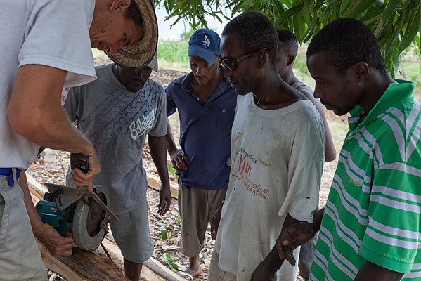 Jan teaching the locals how to use a circular saw.  For many of them it's the first time they've seen such a thing.