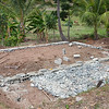 The foundation of the hen house in La Hatte with one post sunk.