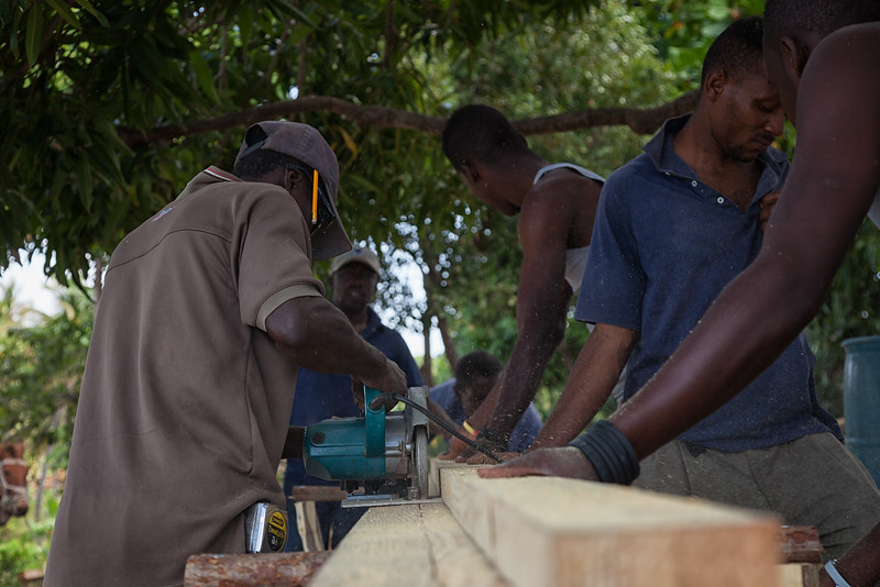 Our carpenter cutting materials for the roofing of the hen house.