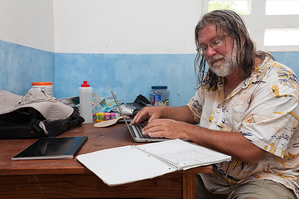 Captain Wayne transcribing notes from the medical clinic at La Hatte school.