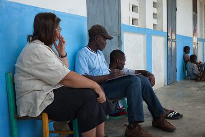 Bienamié writing a deposition after the school headmaster received machete threats.