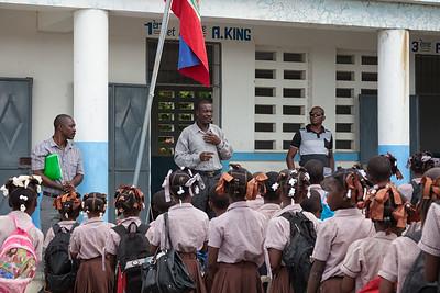Bienamié, school superintendent, welcoming the children back to school.