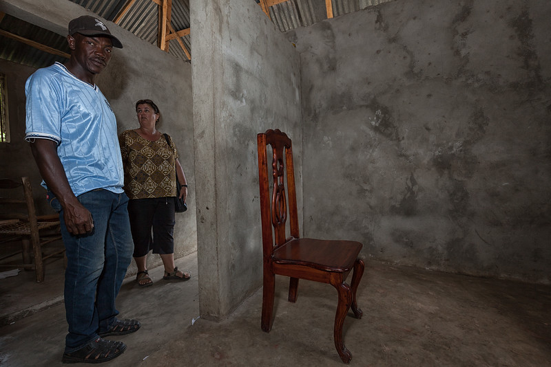 Mandy and Bienamié inspect one of the tiny rooms currently being used as a classroom until the main school in La Hatte becomes operational.