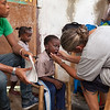 Emily inspects teeth during the health assessment.  There is no dental care on the island.