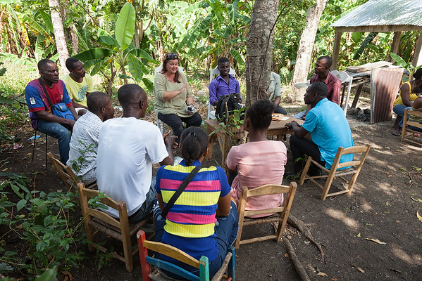 Mandy meets with the teachers at the temporary school, discussing plans to take back the school that was originally built for them.