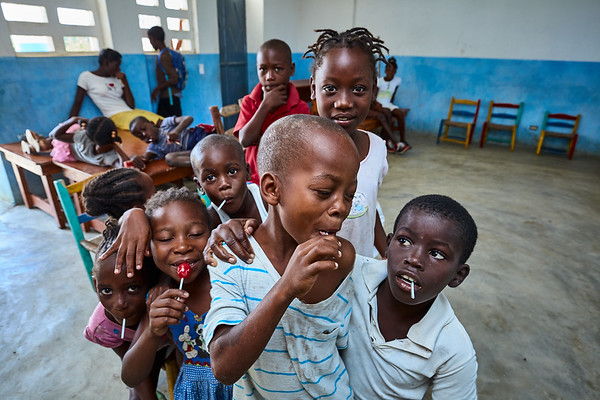 Children enjoy some pops during their health assessment in La Hatte.