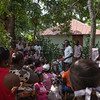Teachers passing out report cards at the site of the temporary school in La Hatte.