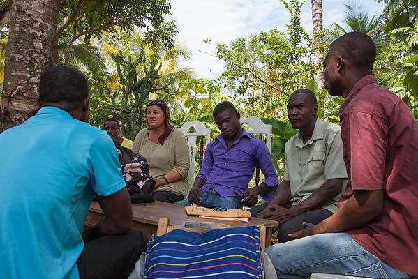 Mandy and Bienamié, the school superintendent (2nd from right), discuss the next steps for the school with the teachers.