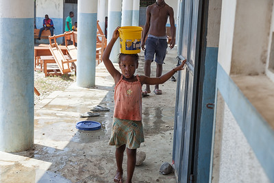 This girl was quite enthusiastic about cleaning the school!  She carried a lot of loads of water on her head.
