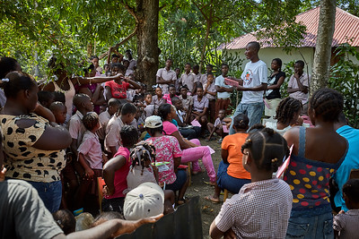 Parents get to see their childrens' progress during distribution of report cards at the temporary school in La Hatte.