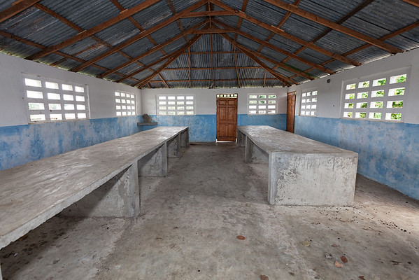 Concrete slabs make up the tables of the dining hall of the school in La Hatte.