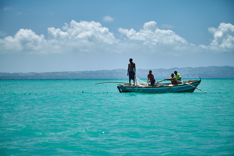 Fishermen casting a net in Baie La Hatte.  The net is cast around the entire bay and then pulled in from shore.