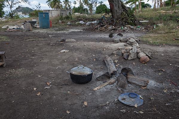 Smoldering cooking fire in La Hatte, Ile A Vache, Haiti.
