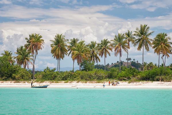 Children play on the beautiful beach in La Hatte, Ile A Vache, Haiti.