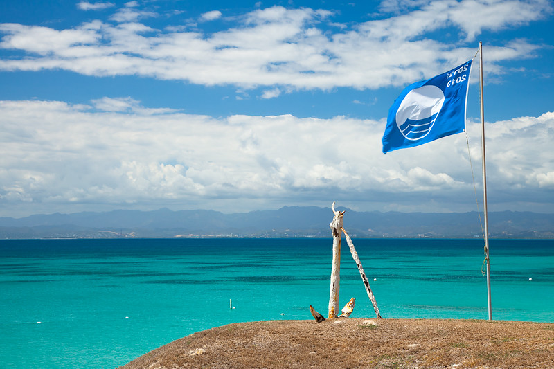 Looking towards Ponce from Isla Caja de Muertos Nature Reserve.  The Blue Flag is an international eco-award given to beaches with exceptional water quality, environmental education, environmental management, and safety.