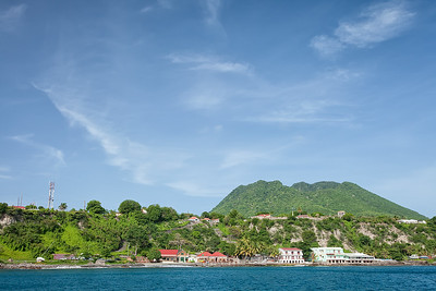 """""""Lower Town"""", Oranjestad and Mount Mazinga (The Quill) looming overhead"""