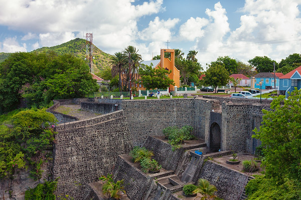 After heavy rains, water winds through the town and down this wall at the top of Upper Town, Oranjestad.  From Fort Oranje