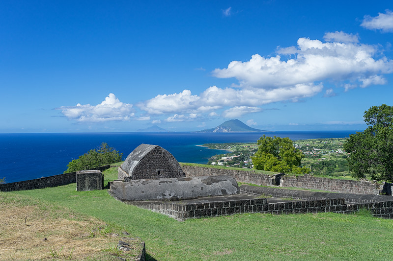 Magazine Bastion with St. Eustatius and Saba in the background.  A water catchment system and cistern are in the foreground.