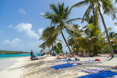 The beach on the leeward side of Petit Bateau after the cruise ship landed.