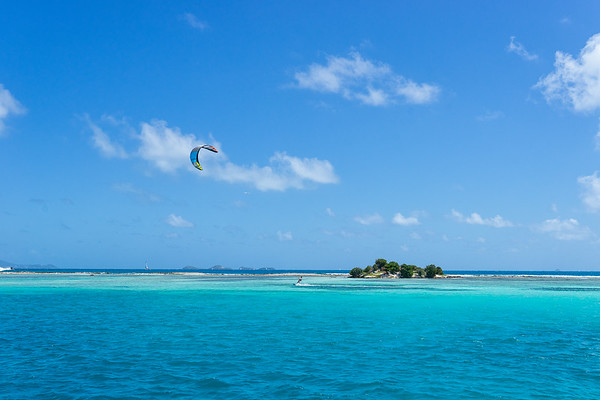 Kitesurfing in front of Green Island, in the protected waters in front of Clifton, Union Island.