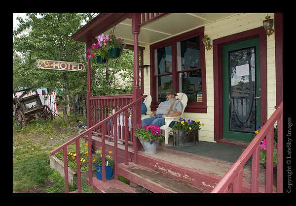 555 - Guests on the flower-studded porch at the historic Ma Johnson's Hotel command a prime viewing spot for the festivities.