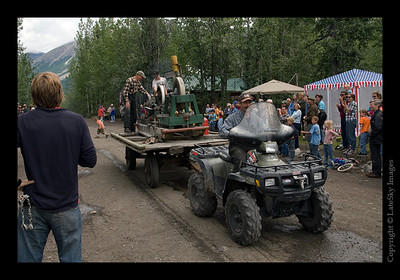 617 - A 4-wheeler pulling a trailer with local residents displaying an old machine from the 1900's mining era that still runs!